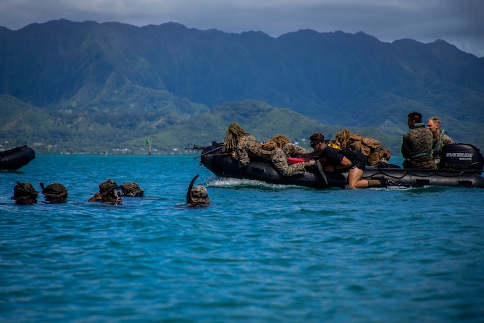 U.S. Marines with Lima Company, 3rd Battalion, 3d Marine Regiment, participate in an amphibious assault exercise, Marine Corps Base Hawaii, May 28, 2020. Bravo Company, 1st Battalion, 3d Marine Regiment, and Lima Company, 3rd Battalion, 3d Marine Regiment, conducted an amphibious assault exercise and military operations in urban terrain to increase littoral mobility proficiency in 3d Marine Regiment and advance the goals of the Commandant of the Marine Corps 2030 Force Design. (U.S. Marine Corps photo by Cpl. Matthew Kirk)