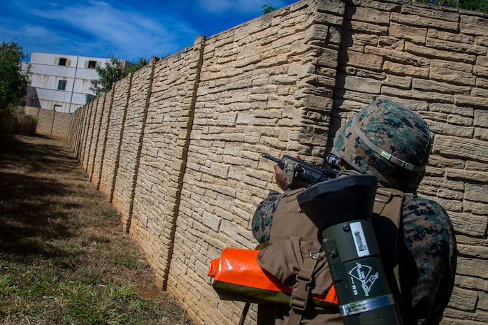 U.S. Marine Corps Lance Cpl. Hector Pereyrabaez, a rifleman with Bravo Company, 1st Battalion, 3d Marine Regiment, posts security during military operations in urban terrain training, Marine Corps Base Hawaii, May 28, 2020. Bravo Company, 1st Battalion, 3d Marine Regiment, and Lima Company, 3rd Battalion, 3d Marine Regiment, conducted an amphibious assault exercise and military operations in urban terrain to increase littoral mobility proficiency in 3d Marine Regiment and advance the goals of the Commandant of the Marine Corps 2030 Force Design. (U.S. Marine Corps photo by Cpl. Matthew Kirk)