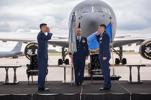 Lt. Col. Joshua Moores, right, accepts command of the 344th Air Refueling Squadron during a change of command ceremony May 27, 2020, at McConnell Air Force Base, Kansas. Under Moores' command, the 344th will continue developing as the KC-46A Pegasus becomes fully mission capable. (U.S. Air Force photo by Staff Sgt. Chris Thornbury)