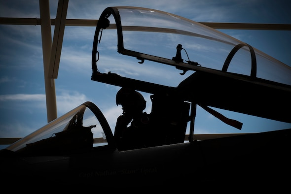 A pilot prepares in is aircraft