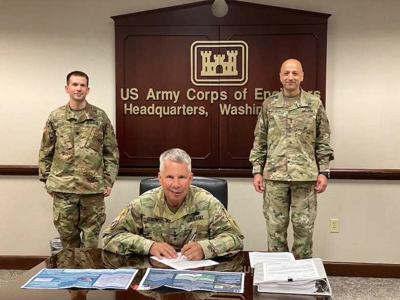 Lt. Gen. Todd T. Semonite, commanding general of the U.S. Army Corps of Engineers and 54th U.S. Army Chief of Engineers, signs the Chief's Report for the Port of Nome Modification Feasibility Study.