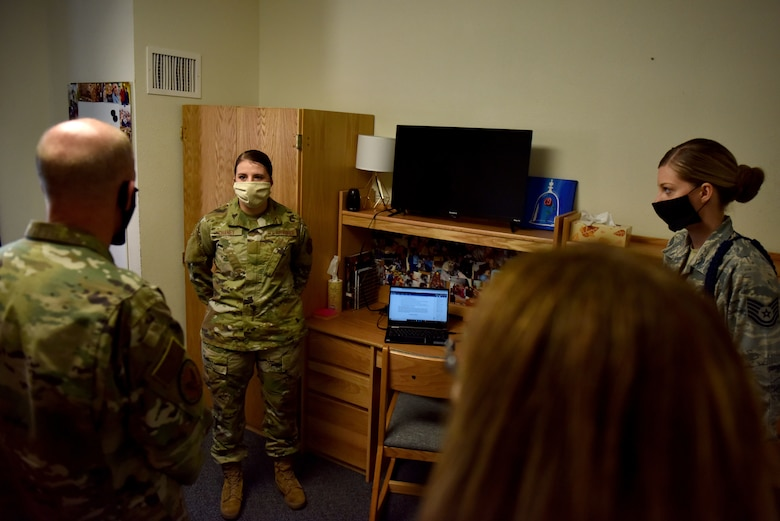 U.S. Air Force Airman Alyxandria Chaney, 316th Training Squadron student, explains to General Stephen Wilson, vice chief of staff of the Air Force, her daily routine of distance learning from her dorm room since the COVID-19 pandemic at the 316th TRS squadron housing on Goodfellow Air Force Base, Texas, May 29, 2020. Students now participate in a hybrid class allowing them to study and learn from either their dorm room or computer labs within the squadron housing. (U.S. Air Force photo by Senior Airman Seraiah Wolf)