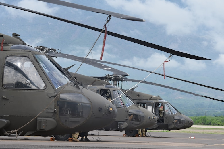 Members of the U.S. Army 1st Battalion, 228th Aviation Regiment conduct pre-flight checks on three UH-60L Blackhawks prior to a Battalion Continuity of Operations (COOP) training flight formation over Honduras and El Salvador, May 28, 2020.