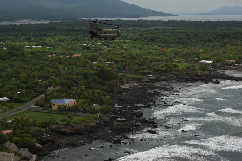 A U.S. Army CH-47 Chinook assigned to the 1st Battalion, 228th Aviation Regiment flies over the coast of Honduras and El Salvador during a Battalion Continuity of Operations (COOP) training flight formation May 28, 2020.