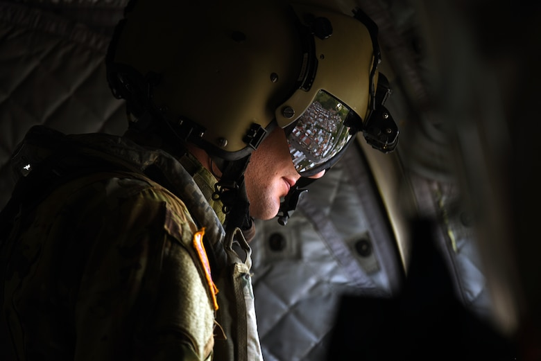 U.S. Army Sgt. Joseph Reddin, a crew chief assigned to the 1st Battalion, 228 Aviation Regiment, based out of Soto Cano Air Base, Honduras, surveys the Central American landscape from a CH-47 Chinook during a Battalion Continuity of Operations (COOP) training flight.