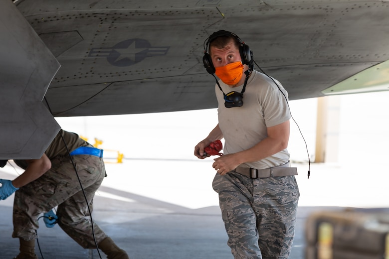 Tech. Sgt. Dustin Packer, 412th Aircraft Maintenance Squadron, conducts a visual inspection of an F-22 Raptor as part of an operational rapid crew swap at Edwards Air Force Base, California, April 30. (Photo courtesy of Kyle Larson/Lockheed-Martin)