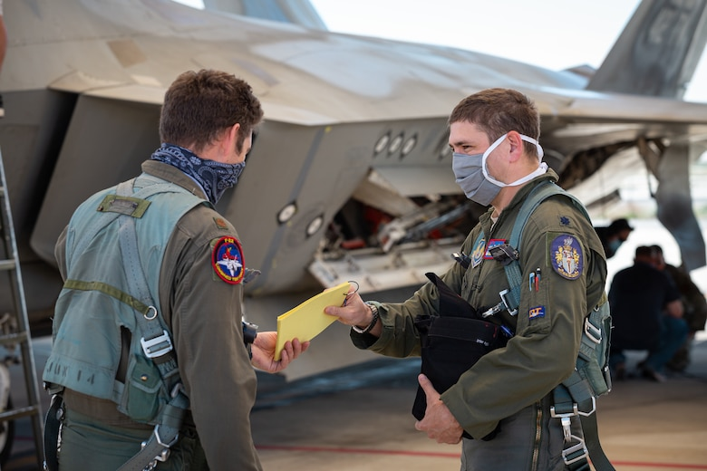 Maj. Benjamin Gilliland and Lt. Col. Tyler Robarge, both of the 411th Flight Test Squadron and F-22 Raptor Combined Test Force, conducted the base's first operational rapid crew swap at Edwards Air Force Base, California, April 30. Robarge flew the first sortie and then swapped seats with Gilliland for the following sortie. (Photo courtesy of Kyle Larson/Lockheed-Martin)