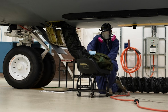 Airman 1st Class Dezmond Ross, 100th Maintenance Squadron fuel systems repair apprentice, puts on his static-resistant suit at RAF Mildenhall, England, May 27, 2020. The suit is worn inside fuel cells to protect Airmen from hazardous materials and to limit the creation of static electricity in an environment containing fuel vapor. (U.S. Air Force photo by Airman 1st Class Joseph Barron)
