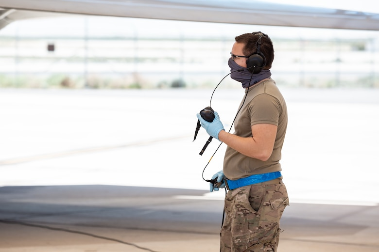 Senior Airman Gilbert Reyes-Camacho, 412th Aircraft Maintenance Squadron, talks to an F-22 Raptor pilot prior to takeoff following an operational rapid crew swap at Edwards Air Force Base, California, April 30. (Photo courtesy of Kyle Larson/Lockheed-Martin)