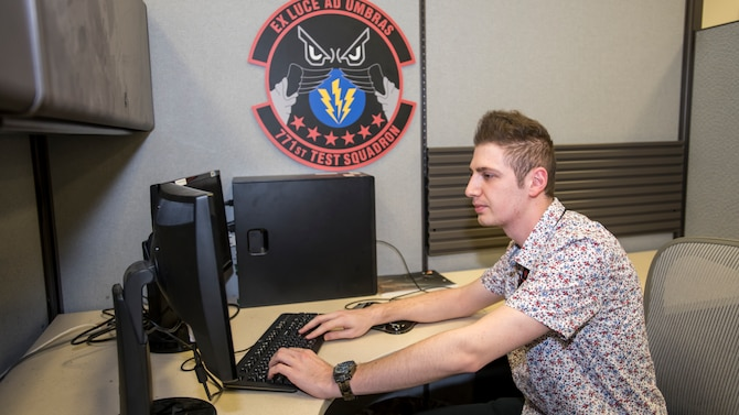 Sasha programmer Rony Maida,771st Test Squadron, developed the machine learning tool to aid engineers in data analytics. (Air Force photo by Giancarlo Casem)