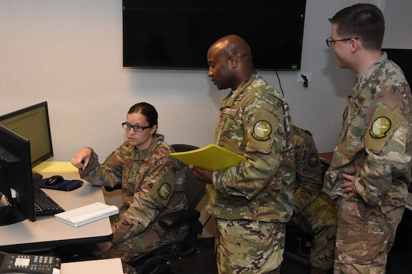 Airmen from the 321st, 621st and 514th Air Mobility Operations Squadrons provided temporary remote Command and Control functions for the Hurricane Michael relief effort here, Oct. 12, 2018. This total force team stood up an Air Mobility Division for the 601st Air Operations Center during its re-location from Tyndall Air Force Base, Fla., after Hurricane Michael destroyed their facilities. (U.S. Air Force Photo by Master Sgt. Charles Larkin Sr.)