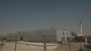 The construction of 10 state-of-the-art dormitories, two dining facilities, and four mission support facilities continues at Al Udeid Air Base, Qatar, May 29, 2020.