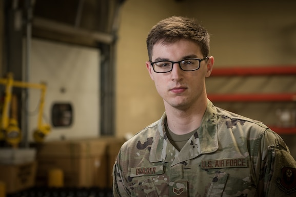 Senior Airman Jake Brader, a Traffic Management Office specialist with the 193rd Special Operations Logistics Readiness Squadron, Pennsylvania Air National Guard, poses for a photo.