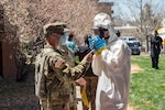 Colorado National Guard Chemical, Biological, Radiological, Nuclear and high-yield Enhanced Response Force Package team members conduct decontamination procedures during COVID-19 testing at a Veterans Community Living Center in Aurora, Colorado, April 29, 2020. By order of Gov. Jared Polis, the Colorado CERFP is assisting the State Emergency Operations Center and Colorado Department of Public Health & Environment to increase testing capacity where needed.  (U.S. Air National Guard photo by Senior Master Sgt. John Rohrer)