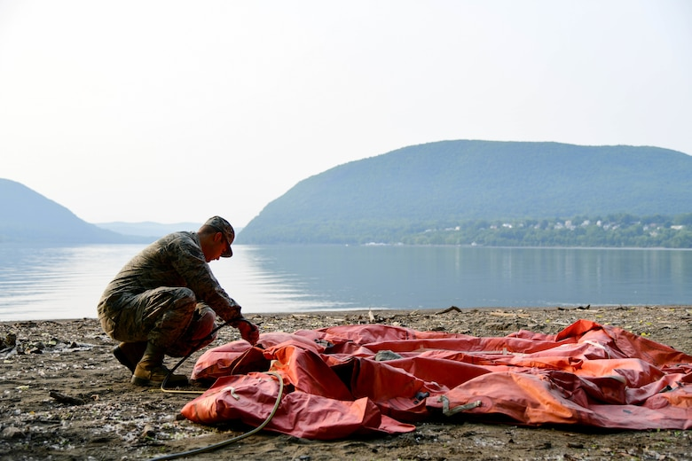 Airmen assigned to the 105th Airlift Wing participate in combat survival training