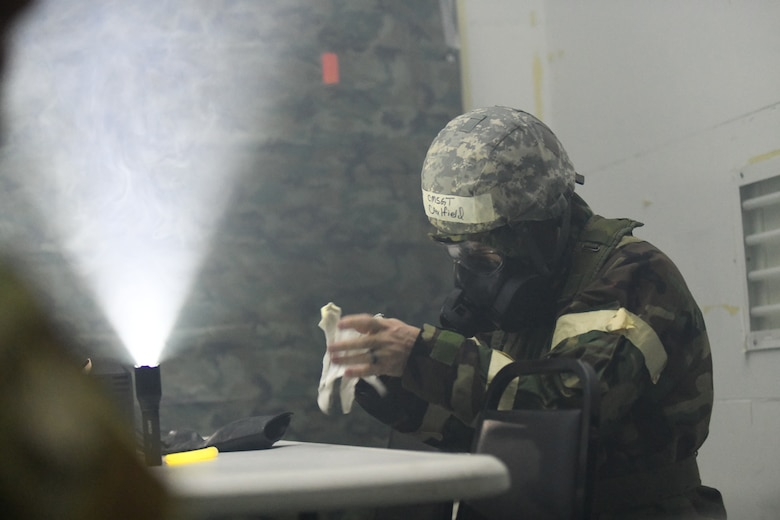 Chief Master Sgt. Joseph Caulfield, 105th AW command chief, prepares for a simulated gas exposure during a joint training, readiness exercise
