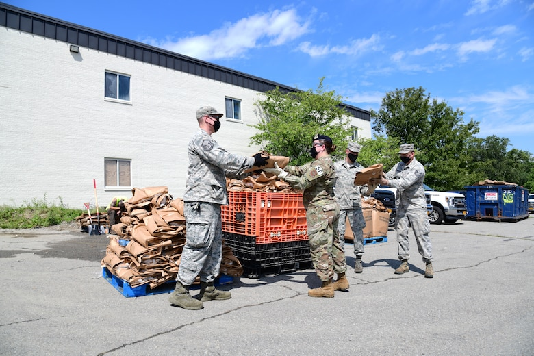 New York Air National Guard Airmen assigned to an Initial Response Force (IRF) from the 105th Airlift Wing based in Newburgh, N.Y. distribute ice and water to Putnam County