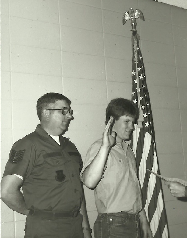 Master Sgt. John Konietzko (ret) watches as his son Kraig Konietzko takes the oath of enlistment at the 148th Fighter Wing in 1985. (courtesy photo)