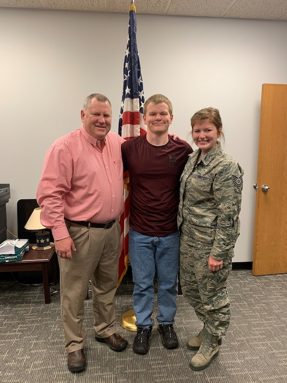 Chief Master Sgt. Kraig Konietzko (ret), Luke Konietzko and Tech. Sgt. Kristianna Konietzko pose for a photo after Luke takes the oath of enlistment at the 148th Fighter Wing in March 2020. (Courtesy Photo)