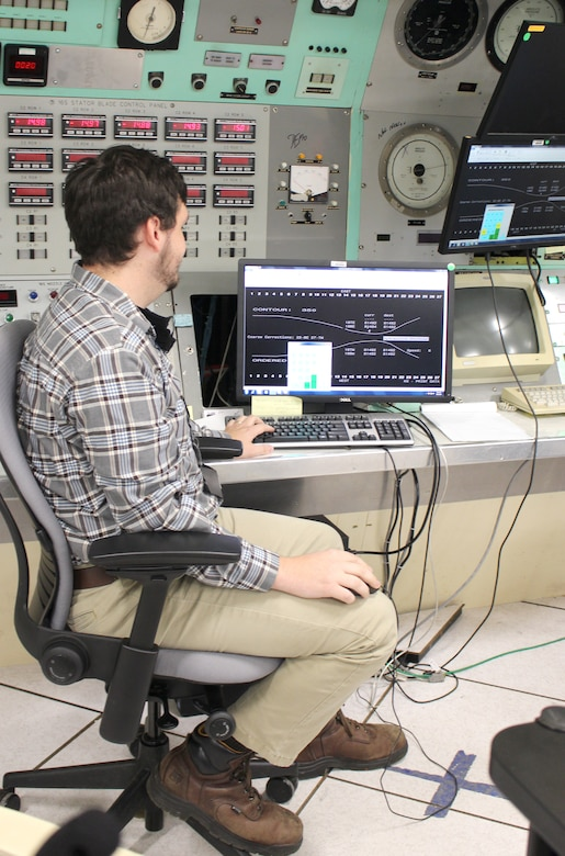 Electrical systems engineer Will Layne views a monitor in the control room of the Arnold Engineering Development Complex 16-foot supersonic wind tunnel Sept. 25, 2020, at Arnold Air Force Base, Tenn. Layne is part of the 16S team assisting with a project to reactivate the nozzle for the test cell. The 16S nozzle was last active in 1997. (U.S. Air Force photo by Deidre Moon) (These photos have been altered by obscuring badges for security purposes.)