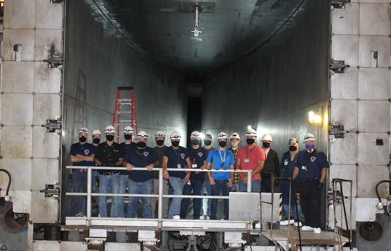 The team working to reactive the Arnold Engineering Development Complex 16-foot supersonic wind tunnel nozzle at Arnold Air Force Base stands in the nozzle of the test cell Sept. 25, 2020. The nozzle which has not been operational since a test in 1997 is now active. (U.S. Air Force photo by Deidre Moon) (This photo has been altered by obscuring badges for security purposes.)