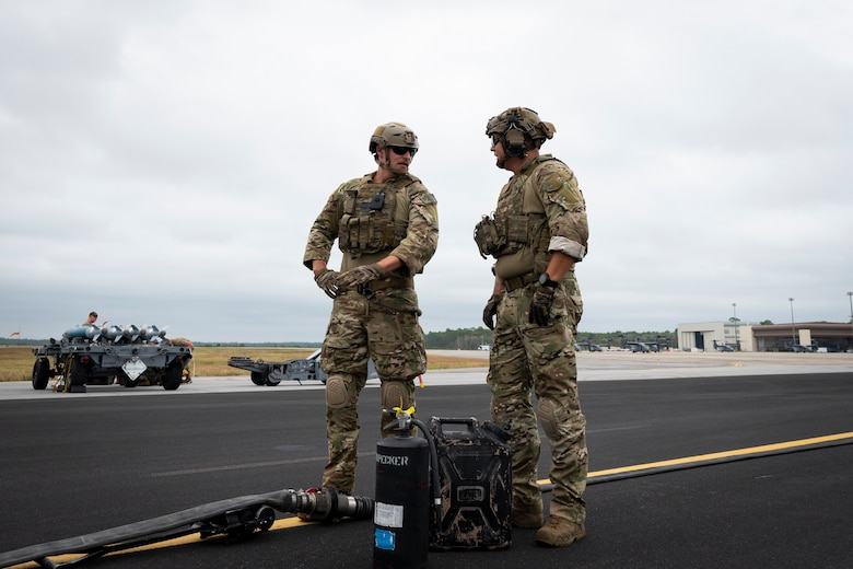 U.S. Air Force Senior Airmen Ryan Ruesewald, left, and Cody Washek, forward area refueling point members assigned to the 1st Special Operations Logistics Readiness Squadron, prepare to conduct a FARP operation during Agile Flag 21-1 at Hurlburt Field, Florida, Oct. 27, 2020.