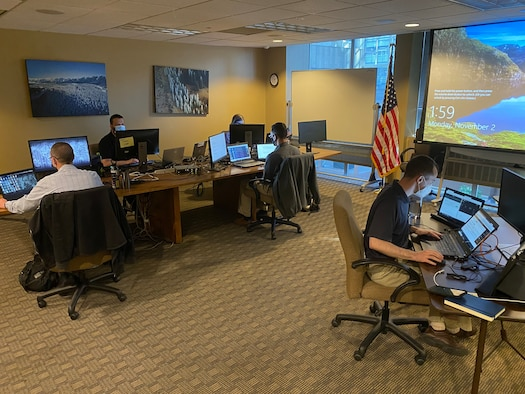 Members of the Colorado National Guard's Task Force Cyber help Colorado Secretary of State's Office and Office of Information Technology to monitor network traffic and protect election infrastructure Nov. 2, 2020, in Denver. (Photo by Maj. Matthew Gaskins)