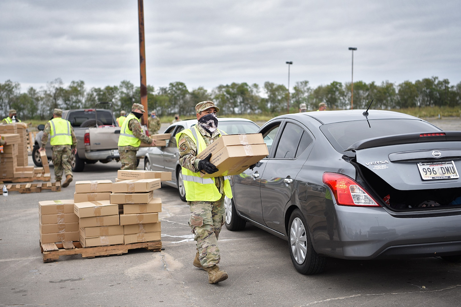 Airmen of the Louisiana Air National Guard's 159th Fighter Wing distribute tarps to citizens following Hurricane Zeta in St. Bernard Parish, Louisiana, Oct. 30, 2020.