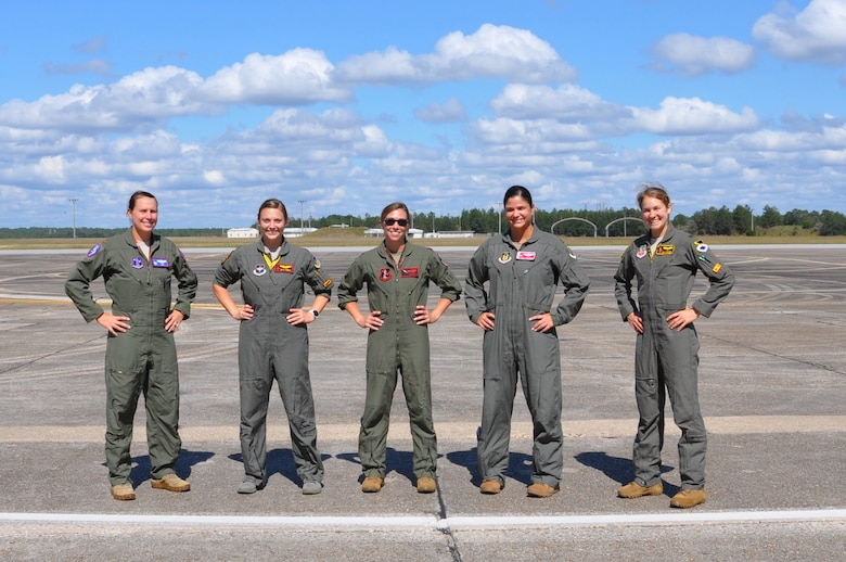 five pilots stand on the flight line