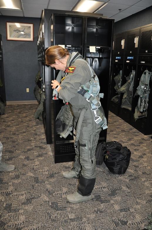 pilot dons gear