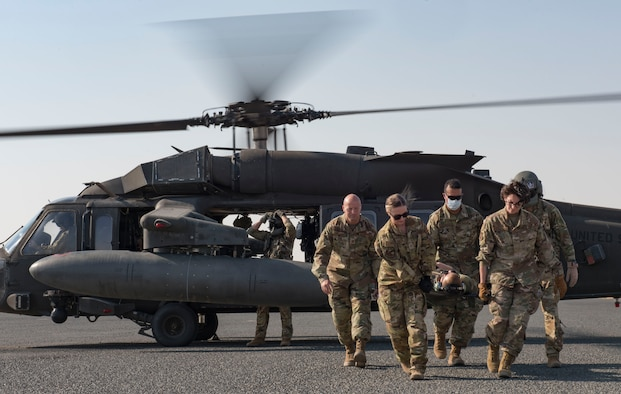 Medical personnel prepare to carry a patient to a UH-60 Black Hawk helicopter for transport during a medical evacuation training exercise at Ali Al Salem Air Base, Kuwait, Oct. 27, 2020.
