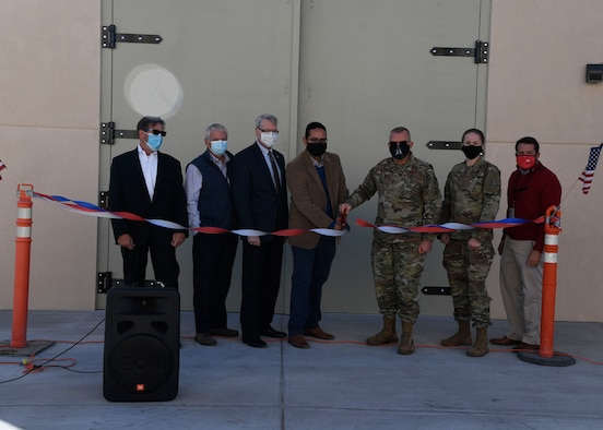 Members of the Air Force Research Laboratory Space Vehicles Directorate and U.S. Army Corps of Engineers celebrate the opening of the Deployable Structures Laboratory at Kirtland Air Force Base, New Mexico, Oct. 29, 2020. The laboratory was constructed by Sky Blue Builders and designed by Studio Southwest Architects, both of Albuquerque, N.M., and will be used for testing novel deployable space structures. (U.S. Air Force photo by Airman 1st Class Ireland Summers)