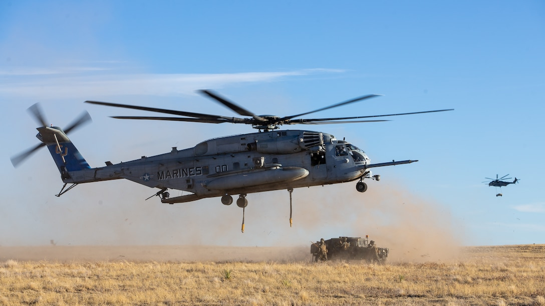Marines with Marine Heavy Helicopter Squadron 461 prepare to transport a Humvee using a CH-53E Super Stallion helicopter during their deployment for training exercise at Colorado Springs, Colorado, Jan. 14, 2020. The purpose of the exercise is to increase the squadron's proficiency in cold weather and high altitude aviation operations and to improve overall combat readiness. HMH-461 is a part of Marine Aircraft Group 29, 2nd Marine Aircraft Wing. (U.S. Marine Corps photo by Lance Cpl. Elias E. Pimentel III)