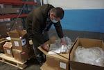 DLA Distribution packs, ships COVID-19 rapid test kits for nursing homes, troops