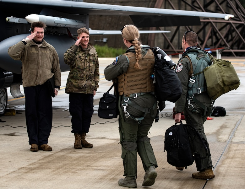 U.S. Air Force Airmen assigned to the 48th Aircraft Maintenance Squadron salute aircrew as they prepare to depart Royal Air Force Lakenheath, England, to Aalborg Air Base, Denmark, Oct. 30, 2020. Agile combat employment within the Baltic airspace and surrounding nations is key to regional defense and stability. Collective training events enhance the ability of NATO forces to work together effectively to fight from varying locations and respond to any threats. (U.S Air Force photo by Airman 1st Class Jessi Monte)