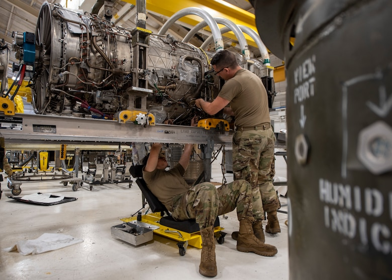 Airman Gaven Shanks, 4th Component Maintenance Squadron aerospace propulsion technician (left), and Airman 1st Class Taran Walsh, 4 CMS aerospace propulsion apprentice, work on an F-15E Strike Eagle engine at Seymour Johnson Air Force Base, North Carolina, Oct. 28, 2020.
