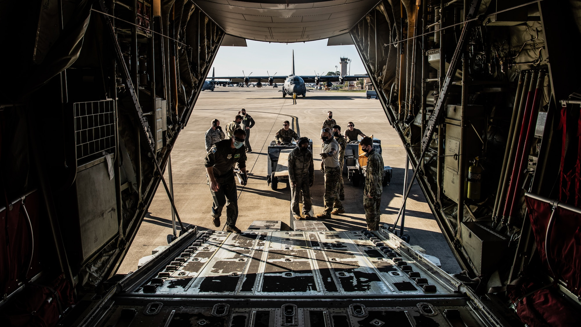 Airmen Loading C-130