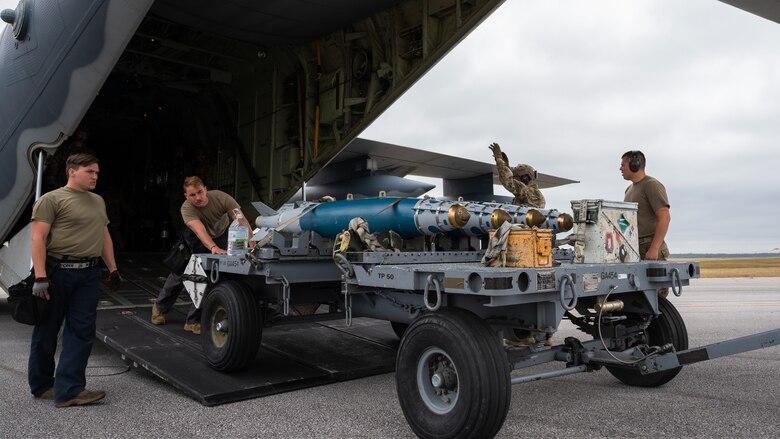 Airmen off loading munitions