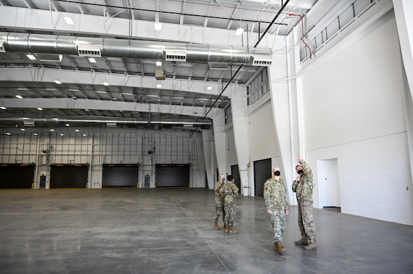 Senior Master Sgt. Dayton Wenzel, 649th Munitions Squadron, walks Chief Master Sgt. Christopher Walker, 75th Air Base Wing command chief, around the new Standarized Air Munitions Package facility Oct. 22, 2020, at Hill Air Force Base, Utah. (U.S. Air Force photo by Cynthia Griggs)