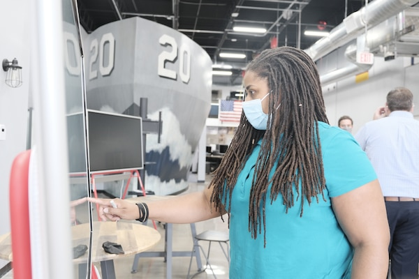 Ashlee Floyd from Naval Surface Warfare Center, Carderock Division works on a SmartBoard to navigate NavalX's online event calendar portal on Oct 13, 2020.