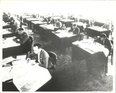 In this historical image, officers take part in a map reading exercise in the 1930s at the Air Corps Tactical School, Maxwell Field, Alabama. The school moved from Langley Field, Virginia, to Maxwell Field in 1931. With its first class starting on Nov. 1, 1920, at Langley Field, it was first called the Air Service Field Officers School then Air Service Tactical School before being renamed Air Corps Tactical School in 1926, five years before its move to Maxwell. (Courtesy photo)