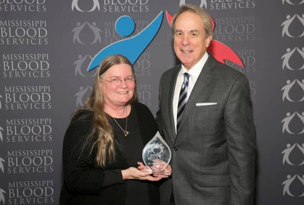 Ruth Osburn, a nurse in Health Services at the U.S. Army Engineer Research and Development Center, poses with David Allen, chief executive officer of Mississippi Blood Services, at a 2018 ceremony where Osburn was recognized as the State of Mississippi Blood Drive Chairperson of the Year for her work in organizing four drives at ERDC.