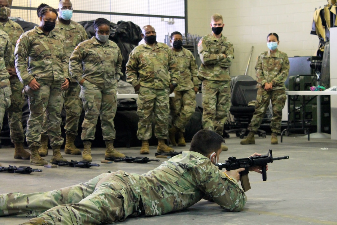 A group of 377th Theater Sustainment Command Soldiers watches a primary marksmanship demonstration during a battle assembly in Belle Chasse, Louisiana October 25, 2020.