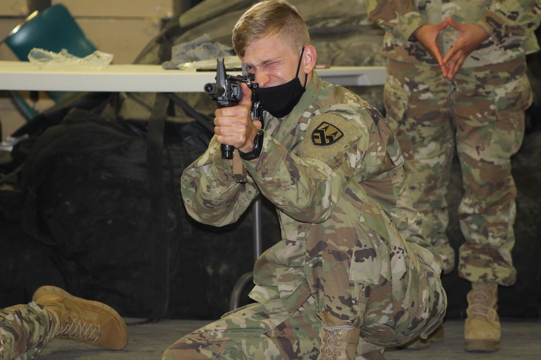 Spc. Brian Hartman, a generator mechanic assigned to the 377th Theater Sustainment Command, aims at a target during primary marksmanship instruction in Belle Chasse, Louisiana, October 25, 2020.
