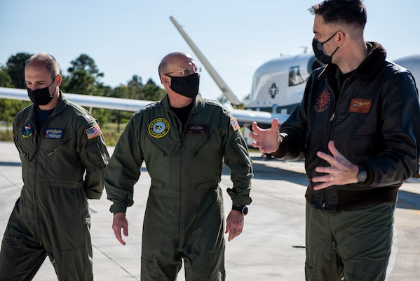 NAVAL AIR STATION PATUXENT RIVER, Md. (Nov. 3, 2020) Chief of Naval Operations (CNO) Adm. Mike Gilday is briefed on the MQ-4C Triton Unmanned Air System during a tour of Naval Air Station Patuxent River. (U.S. Navy photo by Mass Communication Specialist 1st Class Raymond D. Diaz III/Released)