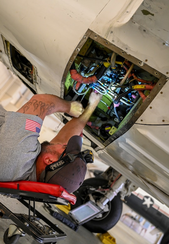 Jason Nesser, M1 Support Services fuel systems lead, inspects the fuel system of a T-6A Texan II on Oct. 29, 2020, at Columbus Air Force Base, Miss. Because of its excellent thrust-to-weight ratio, the T-6 can perform an initial climb of 3,100 feet (944.8 meters) per minute and can reach 18,000 feet (5,486.4 meters) in less than six minutes. (U.S. Air Force photo by Airman 1st Class Davis Donaldson)