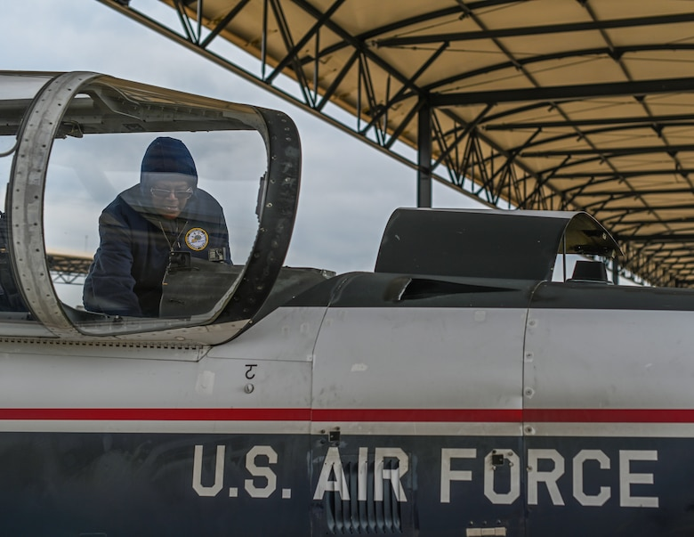 Charlotte Lindsey, M1 Support Services T-6A Texan II maintainer, prepares the cockpit of a T-6 on Oct. 30, 2020, at Columbus Air Force Base, Miss. The T-6 is fully aerobatic and features a pressurized cockpit with an anti-G system, ejection seat and an advanced avionics package with sunlight-readable liquid crystal displays. (U.S. Air Force photo by Airman 1st Class Davis Donaldson)