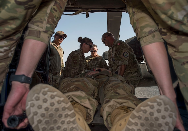 Medical personnel load a patient onto a UH-60 Black Hawk helicopter during a medical evacuation training exercise at Ali Al Salem Air Base, Kuwait, Oct. 27, 2020.