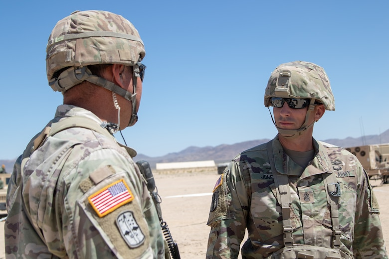 West Virginia Army National Guard (WVNG) State Command Sgt. Maj. James Jones (right) catches up with a 1-150th Cavalry (CAV) Regiment (REG) Soldier while out in the field at the National Training Center in Ft. Irwin, CA during Operation Hickory Sting July 10, 2019. The WVNG's 1-150th CAV REG will deploy in the fall as part of the 30th Armored Brigade Combat Team. (U.S. Army National Guard Photo by Spc. Brianna Lawrence)