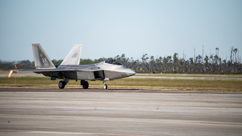 An F-22 Raptor assigned to the 90th Fighter Squadron from Joint Base Elmendorf-Richardson, Alaska, lands at Tyndall Air Force Base, Florida, Oct. 30, 2020. The aircraft arrived to participate in a large scale air-to-air combat exercise known as Checkered Flag. (U.S. Air Force photo by Airman 1st Class Tiffany Price)
